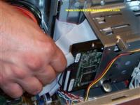 Attaching the power cable to the hard drive.