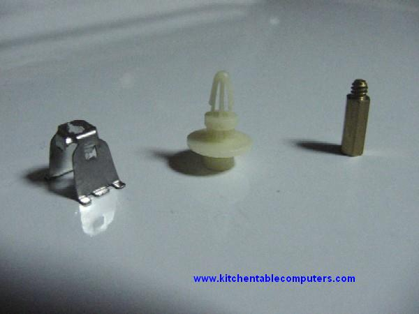 Three kinds of standoffs: one metal clip type, one plastic push in type, and one metal screw in type